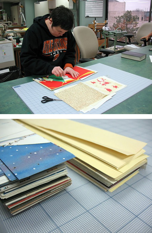 Lori meticulously cut strips from pages of children's books which she will later fold, chain together, and weave into a basket.
