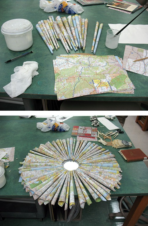 Our conservation volunteer Martha went big!  She rolled maps into a sunburst around a decorative mirror.
