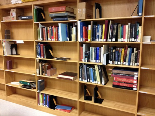 Sorting shelves, where general collections materials await designated repairs.