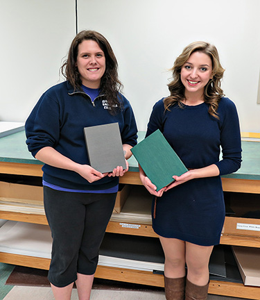 Ashley (l) and Hope (r) show off their newly constructed clamshell boxes.