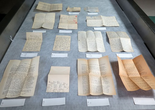 After being stored folded up in their original envelopes for 80 years, these letters require humidification and flattening before they can be safely handled by researchers. Note the letter in the lower right corner, which is very acidic and brittle.