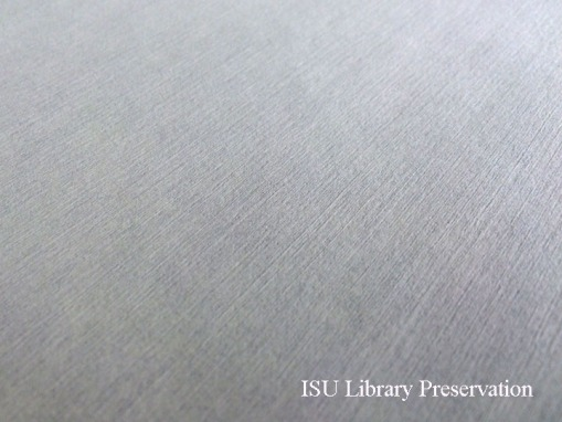 CLose up of the textured surface of Tek wipe, which is a nonwoven polyester and cellulose blend.