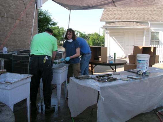IMALERT volunteers rinsing river muck